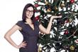 Pretty business woman near christmas tree