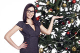 Pretty business woman near christmas tree