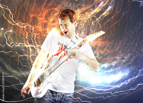 Guitar player with white electric guitar