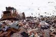 Landfill truck in trash