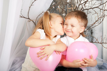 Little couple of kids hugging, kissing