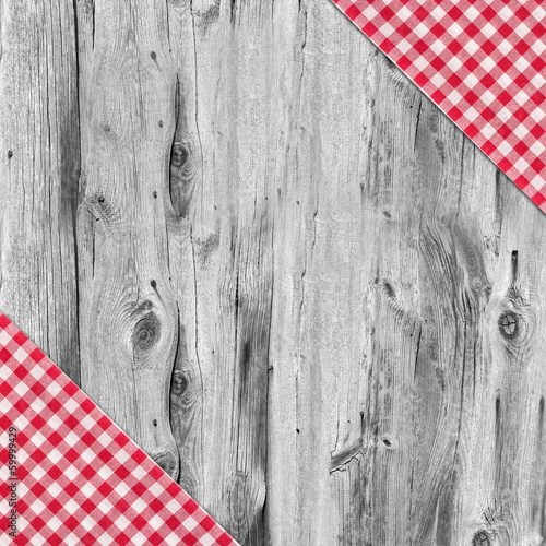 White and red tablecloth textile on wooden table