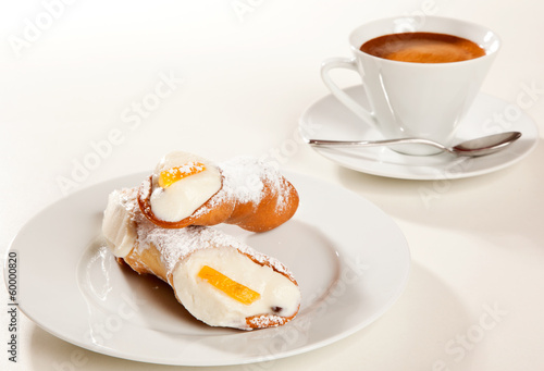 Cannolo with coffee cup
