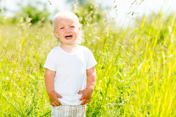 Child crying is on the nature