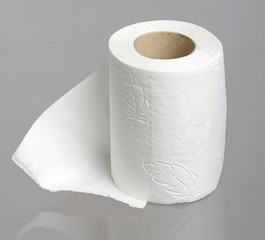 Toilet paper roll on the studio grey background