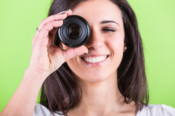 Woman Looking Through Photographic Lens