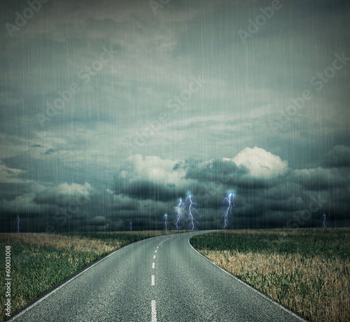 Empty country-road at a apocalyptic thunderstorm