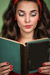 Girl in retro style with emotions reading a book