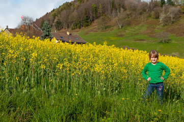 Beautiful little girl standing in raps field