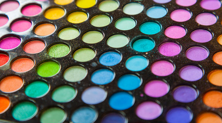 Palette colorful eye shadows. Makeup set background.