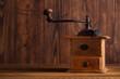Nostalgic coffee grinder on old table