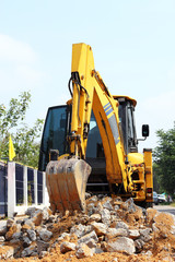 Backhoe loader  clearing land  for construction