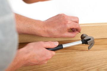 Nailing with hammer