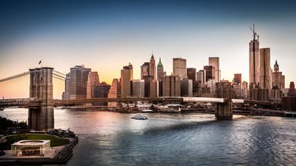 Brooklyn Bridge and the Lower Manhattan at sunset in NY City