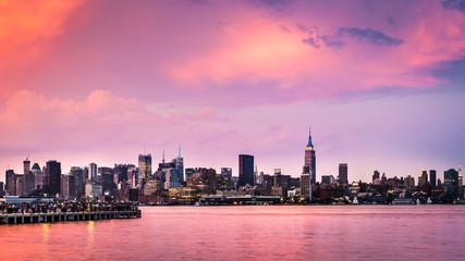 Purple sunset above midtown Manhattan skyline