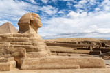Great Sphinx of Giza under a cloudy blue sky