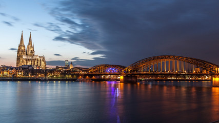 Cologne Cathedral and Hohenzollern bridge at dusk