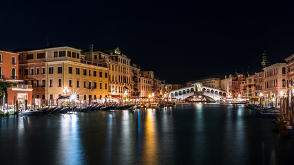 Grand Canal and Rialto bridge by night in Venice