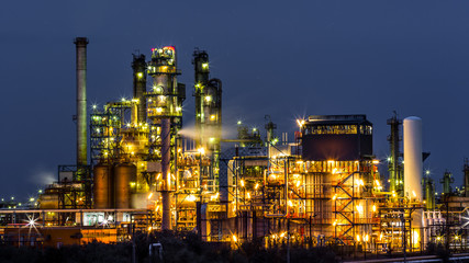 Illuminated oil and gas refinery plant at night