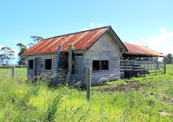 Broken down old Australian farm shed in rural setting