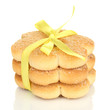 Sweet cookies tied with yellow ribbon isolated on white
