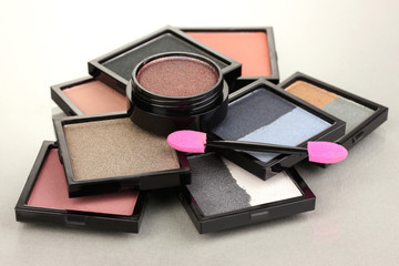 Bright eye shadows and sponge brushes for foundation