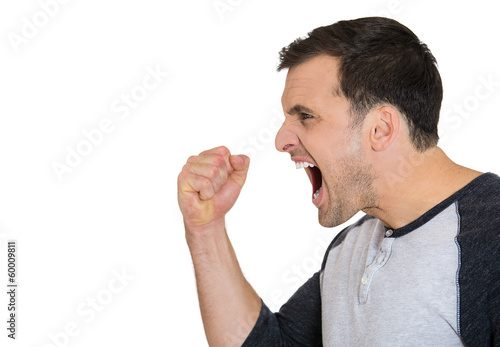 Side view of an angry, frustrated man yelling at someone