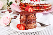 Chocolate cake with strawberry on wooden table close-up