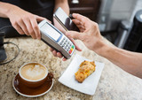 Customer Paying Through Mobilephone Over Electronic Reader At Ca