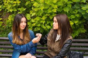 Girls smoking on a bench