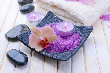 Still life with beautiful blooming orchid flower, towel and