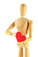Wooden mannequin holding red heart isolated on white