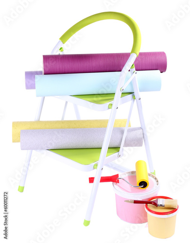 Small ladder and wallpaper rolls, isolated on white