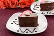 Sweet cakes with chocolate on plate on table close-up