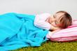 Little girl lying on carpet in room