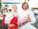 Confident Butchers With Meat Package