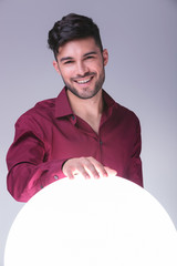 man holding his hand on a big sphere of light