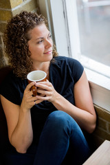 Woman Looking Through Window In Café