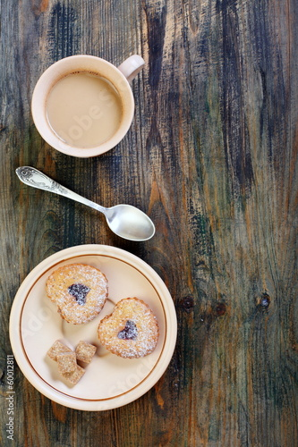 Coffee saucer with biscuits and cane sugar.