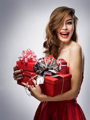 girl in red dress with gifts