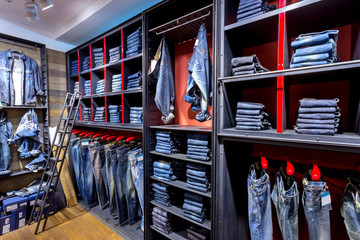 Jeans shirts at shelf in shop