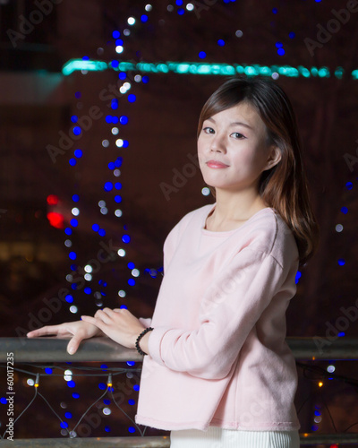 Beautiful Asian Woman with lights in Background