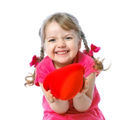 little girl holding a heart