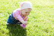 toddler girl crawling on lawn