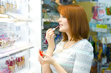 Beautiful young woman in the shop