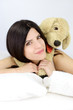 Happy woman smiling with dog plush animal