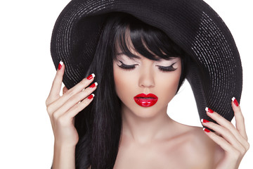 Beauty fashion sexy girl portrait in black hat. Red lips and pol