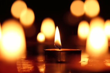Candles light.