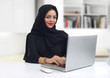 Arabian Businesswoman wearing hijab with notebook in the office