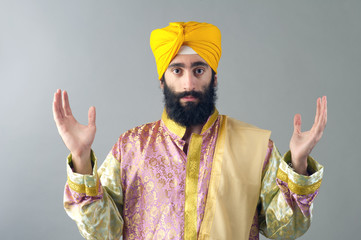 Portrait of Indian sikh man with his hands raised